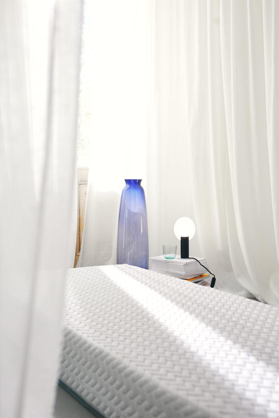 circular mattress with blue vase